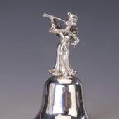 Ezüst kis csengő klarinétos kis angyallal